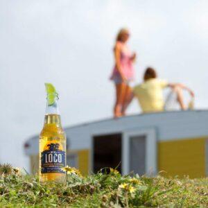 Social media photographer loco beer bottle